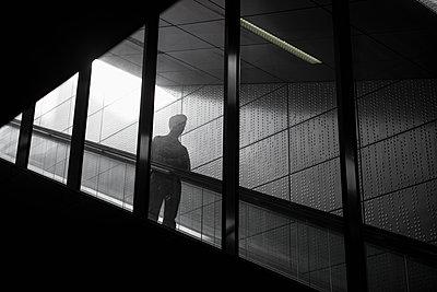 Man on an escalator - p383m1539564 by visual2020vision