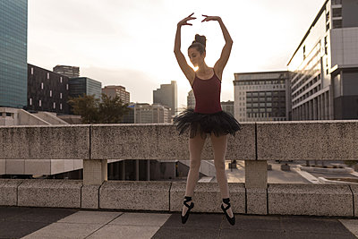 Beautiful woman performing ballet in the city - p1315m2014522 by Wavebreak