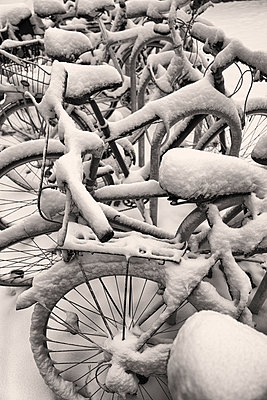 Bike cycles covered in snow winter Black White - p609m1219739 by OSKARQ