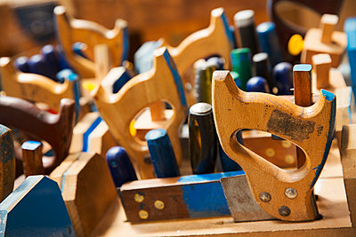 Close up of a woodworking tools in a boat-builder's workshop. - p1100m1490089 by Mint Images