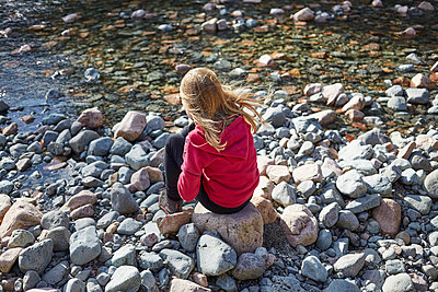 Young girl sat riverside  - p1612m2223700 by Heidi Coppock-Beard