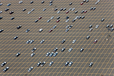 Aerial view of large car park with large number of parked cars. - p1100m1520399 by Mint Images