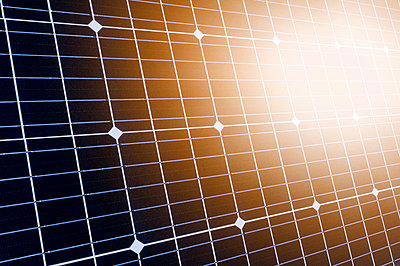 Sunlight reflecting in solar panel - p1427m2202142 by Tetra Images