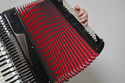 Detail of a man playing an accordion - p30120538f by Paul Hudson