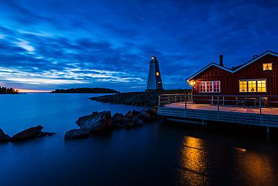 Lighthouse at dusk - p312m2119926 by Johner