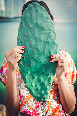 anonymous woman with cactus ear in hands - p1150m2288749 by Elise Ortiou Campion