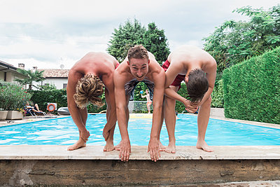 Three young people by the pool - p1437m2008221 by Achim Bunz