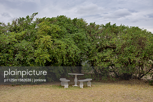 Stone bench and stone table - p1125m1582639 by jonlove