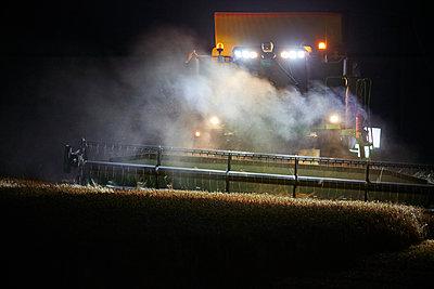 Corn harvest at night - p719m1445922 by Rudi Sebastian