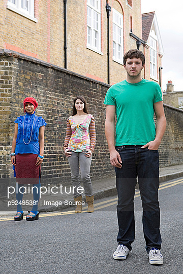 Young people standing in street