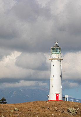 New Zealand, South Taranaki District, Pungarehu, Cloudy sky over Cape Egmont Lighthouse - p300m2156025 by Fotofeeling