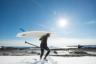 Paddleboarder Heading Into The Cold Atlantic Waters On A Sunny Day - p343m1218243 by Joe Klementovich