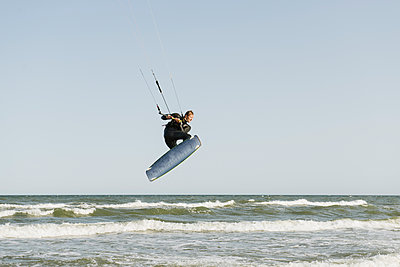 Kiteboarder jumping on the waves - p300m2118626 by Hernandez and Sorokina