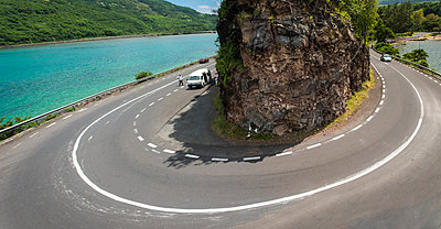 Mauritius; Baie du Cap; view to coast road with curve - p300m919777 by Dieter Schewig