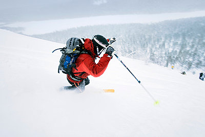 High angle view of a young man skiing - p3741508 by Jukka Rapo