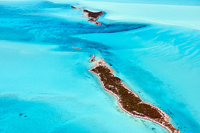 Aerial view of small islands in the shallow waters of the Exumas, Bahamas, West Indies, Central America - p871m2019883 by Rudi Sebastian