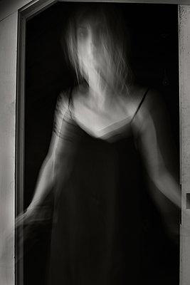 Woman in Doorway - p1503m2031851 by Deb Schwedhelm
