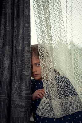 Hiding behind a curtain - p2940810 by Paolo