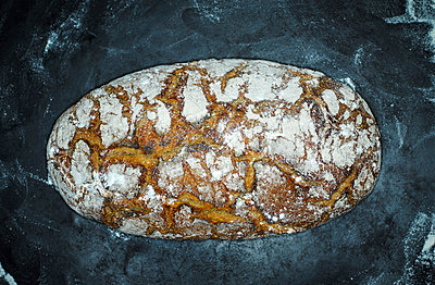Crusty bread on wood - p300m1029137f by Kai Schwabe