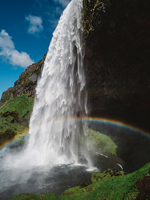 Iceland, Waterfall with rainbow - p1549m2158033 by Sam Green