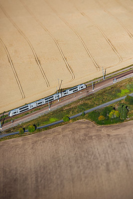Aerial view of train on tracks - p312m1210932 by Hans Berggren
