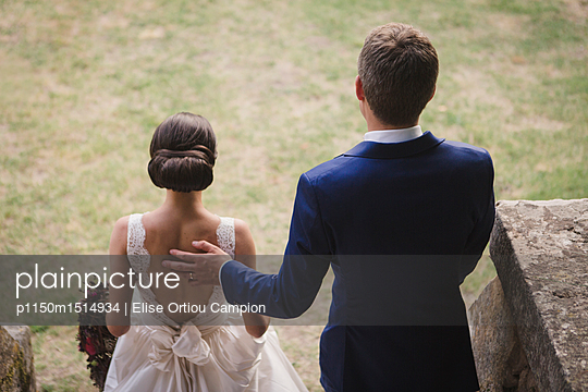 Rear view of bride and groom - p1150m1514934 by Elise Ortiou Campion
