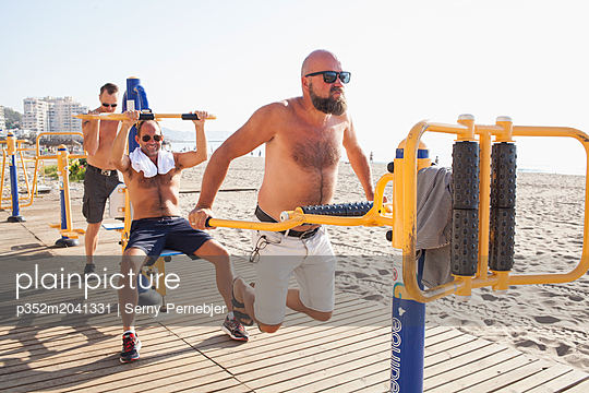 Mid adult men workout on a beach in Fuengirola, Spain