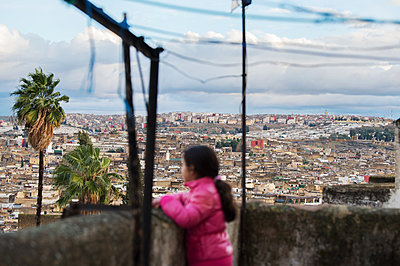Morocco, Fes, Girl on balcony - p1167m2269982 by Maria Schiffer