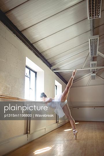 Ballerina practising ballet dance at barre - p1315m1198800 by Wavebreak