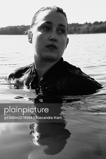 Woman in a lake - p1345m2278994 by Alexandra Kern