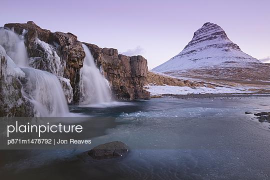 Sunrise at Kirkjufellsfoss and Kirkjufell Mountain, Snaefellsnes Peninsula, Iceland, Polar Regions - p871m1478792 by Jon Reaves