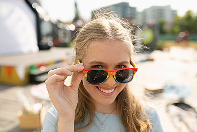 Portrait smiling teenage girl with sunglasses - p1192m2024341 by Hero Images
