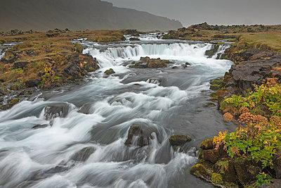 Waterfall through remote landscape, Vik, Iceland - p1023m1030028f by David Henderson