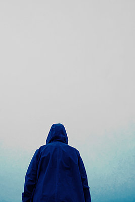 Figure wearing blue hooded anorak  - p597m2055255 by Tim Robinson