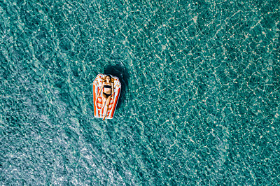 Woman on air mattress in the sea, drone photography - p713m2289234 by Florian Kresse