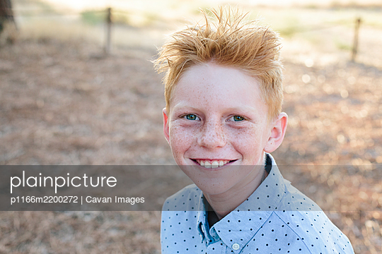 Portrait Of A Happy Freckled Red Haired Boy - p1166m2200272 by Cavan Images