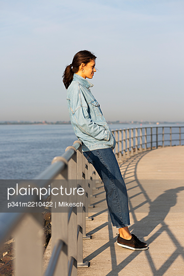 Young woman at the Elbe river - p341m2210422 by Mikesch