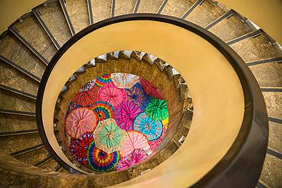 Colourful umbrellas in staircase - p1170m1090768 by Bjanka Kadic