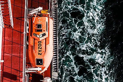 Life boat viewed from above on board a container ship in the Suez Canal. - p343m1130445 by Tim Martin