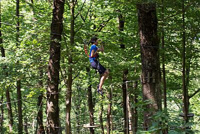 Boy on a Zip Line - p445m1055752 by Marie Docher