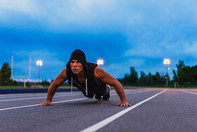 Intense fitness on track - p1362m1227728 by Charles Knox