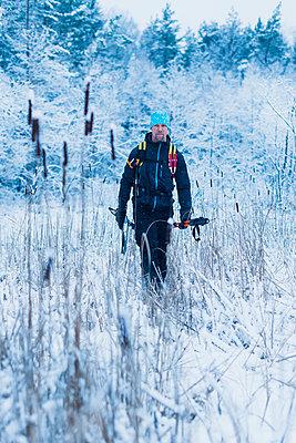Man walking at winter - p312m1103625f by Hans Berggren