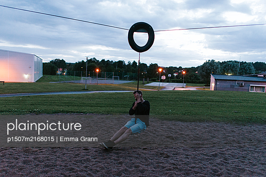 Playground at night - p1507m2168015 by Emma Grann