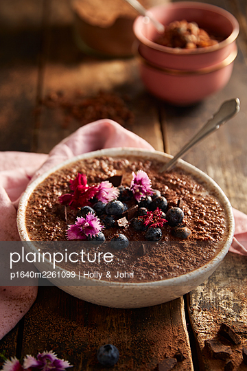 Mousse au Chocolat with spoon and blossoms - p1640m2261099 by Holly & John