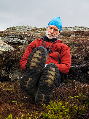 Hiker resting - p312m1187802 by Roine Magnusson