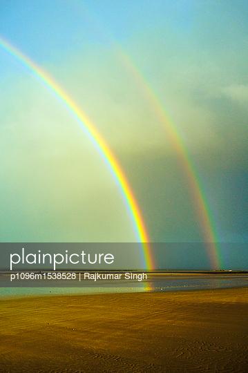 Double rainbow at the beach - p1096m1538528 by Rajkumar Singh