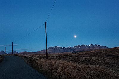 Rural road under full moon - p1477m2039001 by rainandsalt
