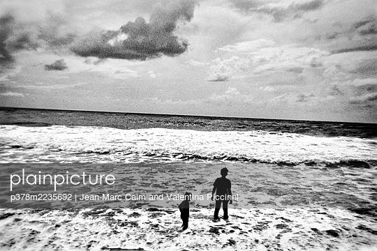 Children on sea shore - p378m2235692 by Jean-Marc Caim and Valentina Piccinni