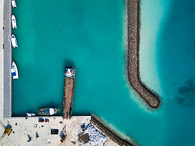 Aerial view of pier and boats, Thulusdhoo, Maldives - p1166m2202334 by Konstantin Trubavin