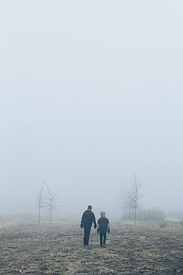 Children Walking Through Fog - p1262m1115682 by Maryanne Gobble